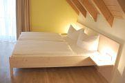 Bett im Zimmer Bacchus