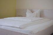 Bett im Zimmer Rivaner