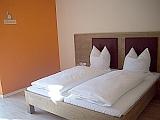 Hotelzimmer Traminer Bett